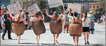 Revelers from PETA in a past Doo Dah Parade/The Virginian-Pilot file