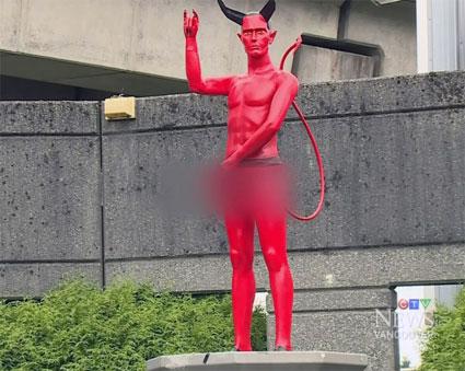 Naked-saluting-Satan-statue